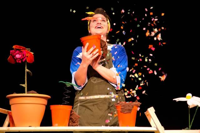 Image-of-woman-with-plant-pot-exploding-with-colourful-paper